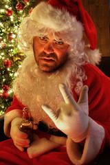 Santa rocking on and drinking beer near tree