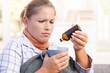 Young female feeling bad taking vitamin