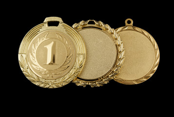 Gold medals isolated on black background