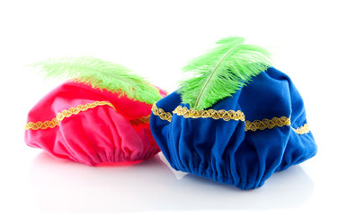 pink and blue hat with green feather of Zwarte Piet