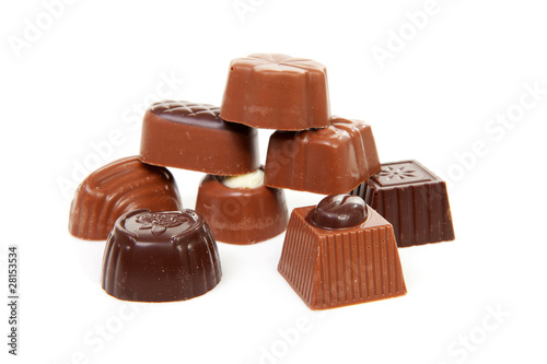 pile of chocolate bonbons over white background