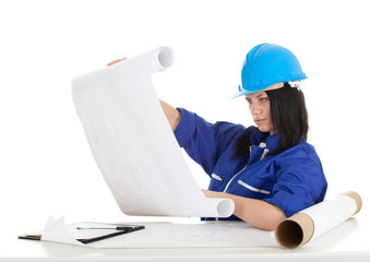 lady architect in overalls and helmet holding  blueprint