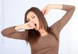 standing beautiful woman yawning and stretching