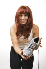 Athletic brunette demonstrates shoe
