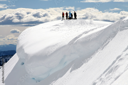 People on Snow-Covered Hill