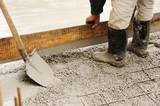 Man leveling concrete slab poster