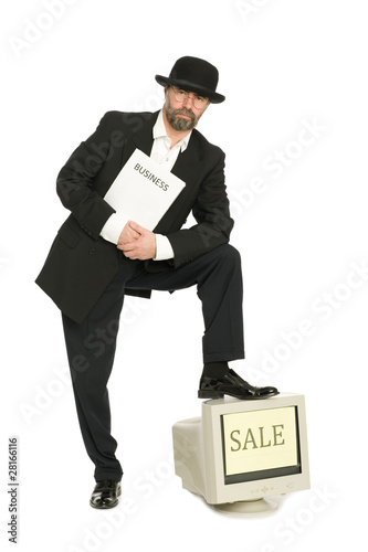 Sale.Businessman in retro business suit sells old computer.