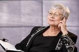 Senior businesswoman using mobile phone