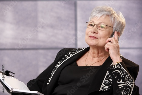 Senior businesswoman using mobile phone