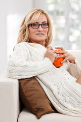 Beauty, blondie woman with an orange coloured cup