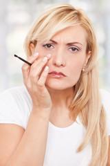 Beauty, worriyng woman making-up