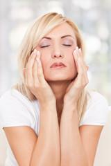 Beauty woman massaging her face