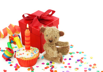 Birthday cupcake with gift box and teddy bear