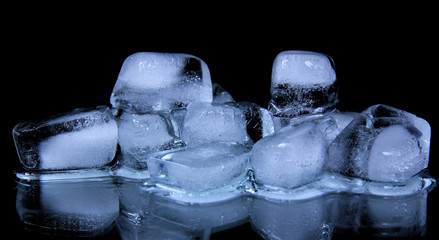 Ice cubes on black background