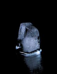 Ice cube on black background