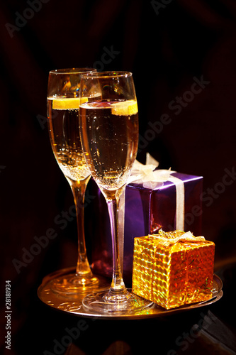 Christmas gift box with glasses of champagne