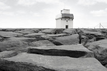 burren lighthouse on rocks
