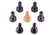 Pawn surrounded by a group of black pawns , isolated on white