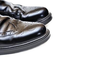 pair of black leather men shoes