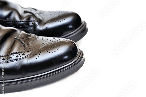 pair of black leather men shoes