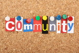 The word Community in magazine letters on a notice board poster