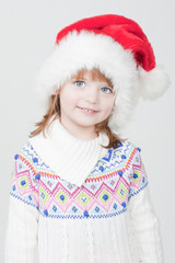 beautiful little girl with Christmas cup