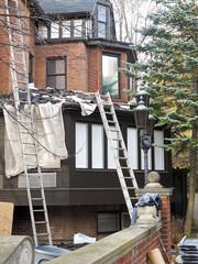 Repairing Roof in residential neighborhood