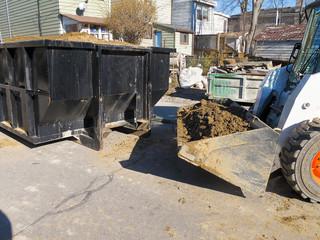 Front end loader and disposal dumpster