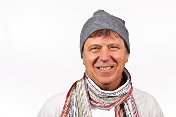 smiling man with winter cap and scarf isolated on white