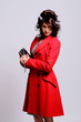 Beautiful young woman in red coat