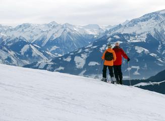 two skiers enjoying mountain view