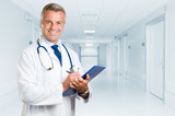 Fototapety Happy smiling mature doctor