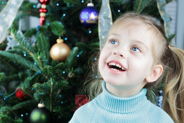 Child by the Christmas Tree