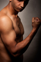 Portrait of young Indian angry man over dark background