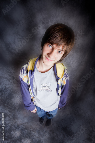 Hip-hop dancer posing on a dark background