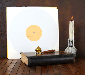 Antique record sleeve with book and candle