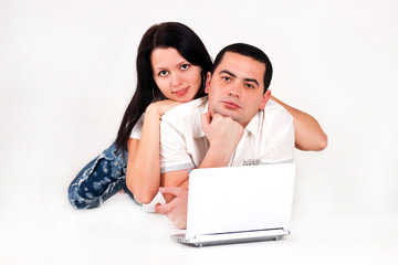 love boy and girl; happy family;Look at the laptop computer