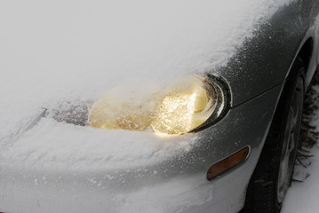 Car headlamp in snow