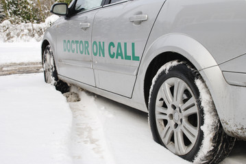 Doctor on call vehicle in snow. England