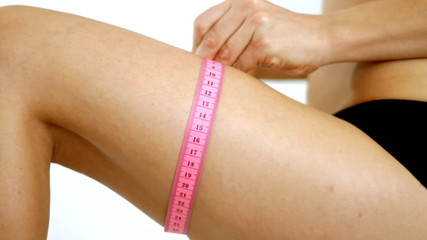 Close up of woman measuring her leg