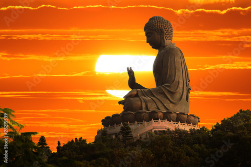 Buddha statue at sunset