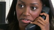 Portrait of African American young woman talking on the phone