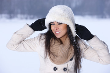 Happy woman relaxing in snowy outdoors