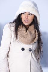 Caucasian brunnette wearing white fur hat