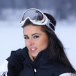 Portrait of happy female snowboarder