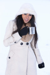 Smiling woman holding cup with hot drink