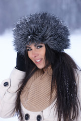 Portrait of attractive woman in winter outdoors