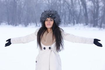 Happy woman with hands open in winter season