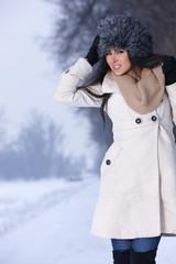 Happy woman relaxing in snowy park