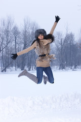 Woman jumping in snowy outdoor